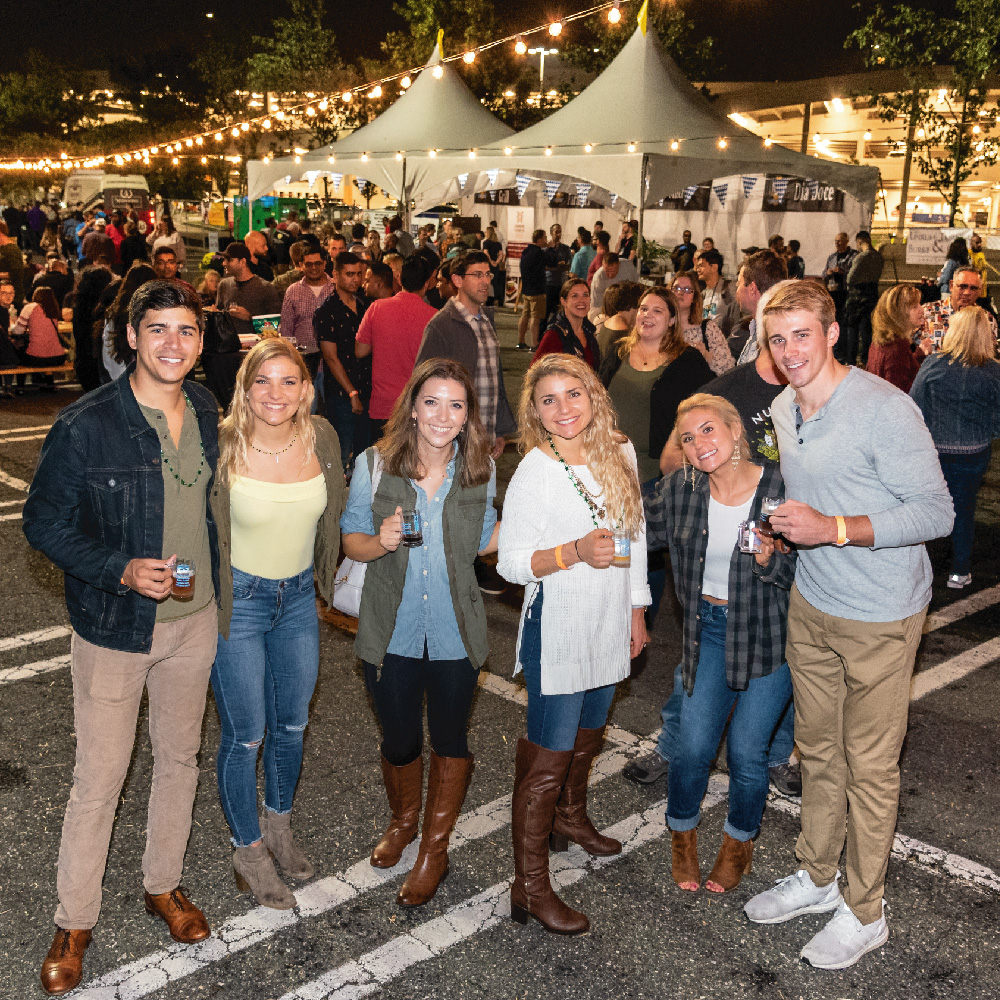 six people smiling for photo outside at beerfest